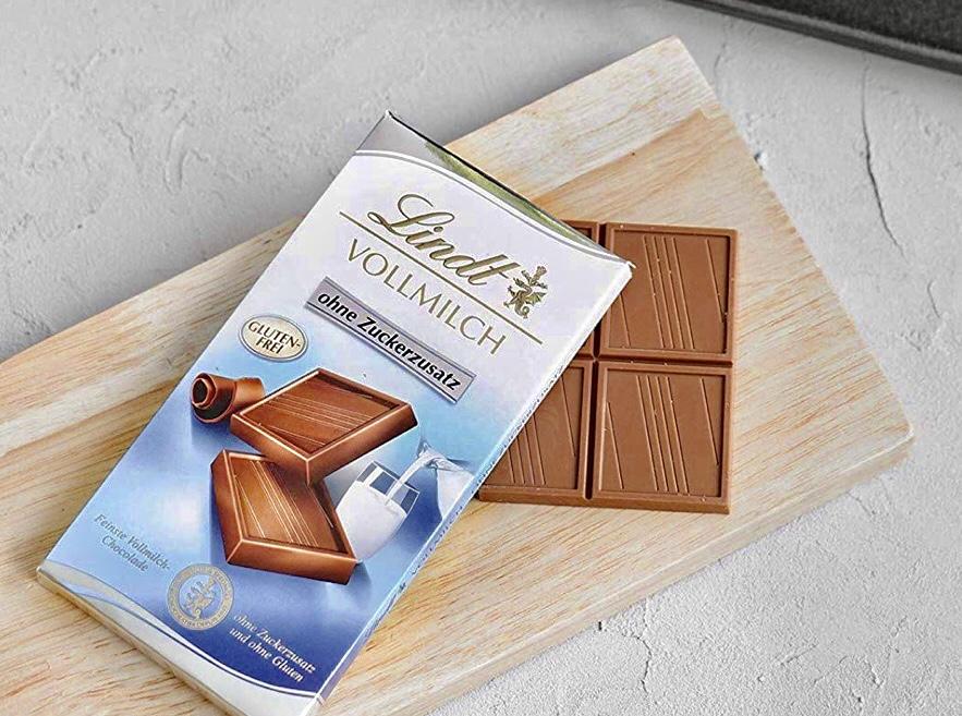 Lindt Vollmilch Schokolade ohne Zuckerzusatz, feinste Lindt Chocolade ohne Zuckerzusatz und ohne Gluten, 4er Pack (4 x 100 g)